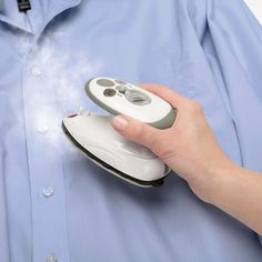 This palm-sized travel iron is the smallest steam iron in the world. Slightly larger than a computer mouse, the iron stores unobtrusively in any carry-on or even a purse yet uses 420-watts to deliver powerful wrinkle-removing steam. The unit heats up in just one minute, has three temperature settings for ironing every kind of fabric including silk, wool, cotton, and linen, and emits burst of steam with the touch of a button. The non-stick soleplate glides across fabric, the water reservoir…