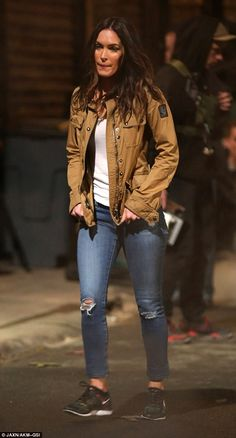 Back in character: Megan Fox was dressed in her character April O'Neil's trademark style as she shot more scenes for Teenage Mutant Ninja Turtles 2 in New York on Thursday