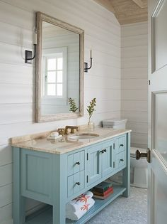 Blue wooden and marble bathroom vanity -