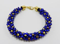 This bracelet is made using the Japanese braiding technique Kumihimo, I have used cobalt blue seed beads and gold seed beads on Superlon S-lon