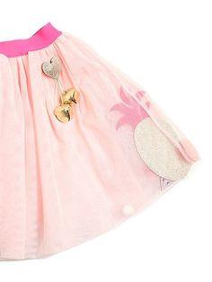 Incluye falda y broche . FALDA:. Cintura elástica. Parches y pompones entre las capas de tul . Forro de muselina algodón. BROCHE:. Corazón con glitter. Campanas
