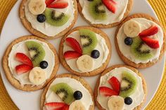 Mini fruit pizzas! sugar cookie crust, and sweet cream cheese frosting