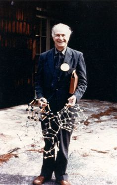 Linus Pauling holding molecular models of water based on the pentagonal dodecahedron, ca. 1960s. LP Photographs