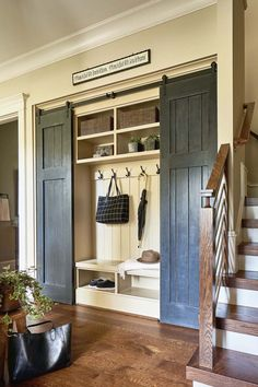 Rufty Homes masterfully crafted a home whose design is based on mountain-inspired living, located in Raleigh, North Carolina. Rufty Custom Built Homes created this home whose design is based on mountain-inspired living, located in Raleigh, North Carolina. Mudroom Laundry Room, Bench Mudroom, Mudroom In Closet, Hall Closet Organization, Entryway Shoe Storage, Boot Storage, Laundry Room Bathroom, Closet Storage, Entry Closet
