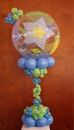 Planning a baby shower!!! consider balloon centerpiece to add a special touch to your celebration...www.BalloontastikCreations.com