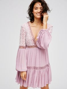 Free People #pastel pink Long sleeve mini dress featuring a gauzy fabrication and pretty tribal-inspired embroidery on the bodice