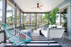 Situated off the living room on the home's first floor, the back deck offers an ideal spot for casual outdoor entertaining and enjoying water views. >> http://www.diynetwork.com/blog-cabin/2016/back-deck-pictures-from-diy-network-blog-cabin-2016-pictures?soc=pinterest