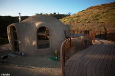 Image: The McWilliams' new homesite now includes a dome home and a combination dome garage/guest house.