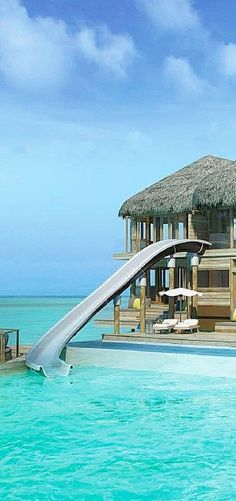 Paradise bungalow with waterslide to the ocean ~ Six Senses Laamu Resort in the Maldives