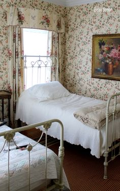 Soft and cozy bed linens/quilt against vintage wrought iron frames