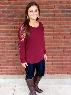 This Sugar Plum Top is a beautiful coral color!  It is right on trend with lace details on the sleeve and a low scoop cut out back. You don't want to miss out on this great top!   Our Model is wearing a medium.   70% Cotton / 30% Rayon   Lining: 100% Polyester