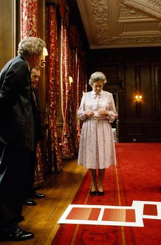 telegraph:  Photos by David Secombe, taken during the filming of the documentary Elizabeth R, 1991-HM Queen Elizabeth II chooses curtain fabric duringher stay at Holyrood House in Edinburgh, Scotland
