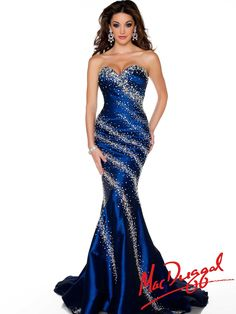 Show off your amazing figure in this form fitting Mac Duggal pageant dress to make a statement. This stretch taffeta Mac Duggal 43018P pageant dress features a sweetheart neckline, exquisite fitted bodice decorated with diagonally scattered ab, clear and navy crystals, and unique mermaid skirt with a train. This shimmering winning pageant competition evening gown is a great choice for your special event.