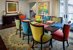 colorful dining chairs. Mine are black, too, so I think this would look awesome. Hate the rug