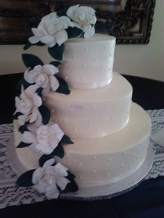 I created the flowers for this wedding cake. It was my first attempt at making sugar gardenias.