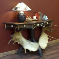 Scalloped Moose Antler Console Table has a unique shape that make this sofa table a great addition to your rustic decor. Antler & Hunting Decor