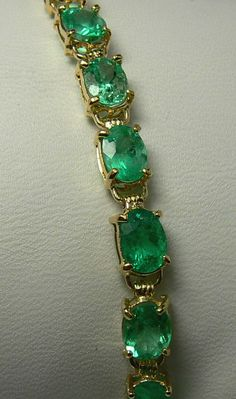 15.0cts Electrifying Oval Colombian Emerald Tennis Bracelet, love the color of these stones.,