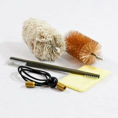Product DescriptionOur Pull Through Grenade Launcher Cleaning Kit cleans all 37mm and 40mm grenade and flare launchers, as well as riot guns.22 Inch Pull Cord – Easily Shortened by the UserSliding Pull Bead2 Brush Adapters with 5/16 x 27 Female Threads1 – 37/40mm Bronze Bore Brush1 – 37/40mm Bore MopGB-5 Double Ended Cleaning BrushGC-2 Silicone Treated ClothAdditional InformationWeight 1.5 lbs