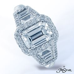 JB Star Handcrafted platinum ring features a stunning 1.71ct emerald cut diamond in prong setting with emerald cut diamond sides and micropave.