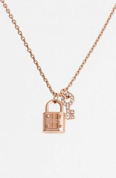 MICHAEL KORS padlock pendant found at Nudevotion.com