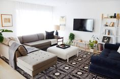 """""""We view our apartment much like an art gallery. A blank canvas for us to display our growing collection of art, furniture and lighting."""""""