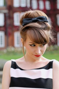 60s-inspired giant hair bun with ribbon bow - if only I had that much hair. Lol!