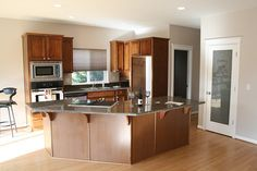 Awesome kitchen with cooktop island, granite tile countertop by jesse k., via Flickr