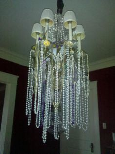 Plastic beads on chandelier-easy decoration for a Mardi Gras party.