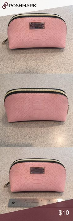 New, Victoria's Secret Makeup Bag New, Never Used  Spacious pale pink snake skin makeup bag with black trim and gold zipper. Has one pocket inside. Victoria's Secret Makeup