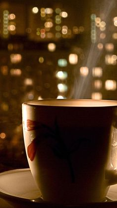 ↑↑TAP AND GET THE FREE APP! Blurred Cup of Hot Drink Brown Delicious Coffee Tasty Tea Evening Cool City View HD iPhone 6 plus Wallpaper