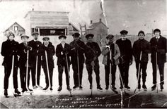 Dupont Hockey Team, 1919 - Eleven team members pose for their photograph on the open-air ice rink near General Motors at Division and Elgin Street. This hockey team was the American Championship Team, Ice Rink, Hockey Teams, General Motors, Division, Photograph, Poses, History, American, Street