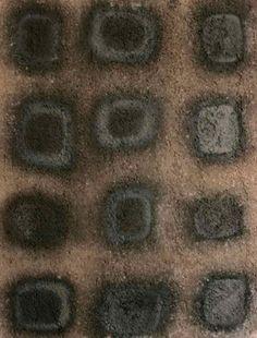 Microcosmo nero  2009 Stele cm36x48  Ceramica- Mix di terre raccolte in toscana e refrattari.  Cottura effettuata a cielo aperto By Giovanni Maffucci
