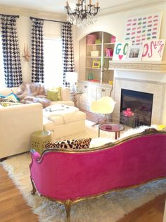 hot pink velvet sofa!! white fur rug! Houndstooth drapes!