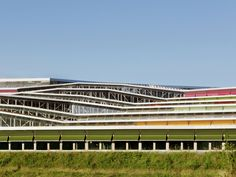 """Nominated for the Mies van der Rohe Award 2017. The Jean Moulin High School is located on a steep slope site. Turning these constraints into a major advantage, a """"balcony in the forest"""" is created. The buildings are absorbed into the folds of the landscap"""