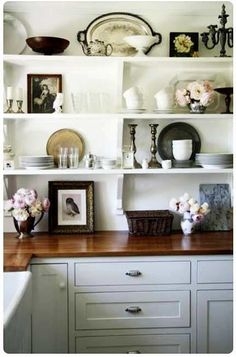 open shelving...love the beautiful arrangement and colors of items of shelves