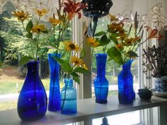 summer flowers in blue vases