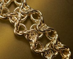 I joined the SCA when I was still a teen, and was immediately drawn to the controlled chaos that is chain maille. I love the elegance and sheer number of possibilities that are possible from combining small circles of wire! Olivia Weave Chain Maille Bracelet by cMaille, via Flickr