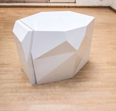 Sculptural Chairs Disappear Into Geometric Table Photo