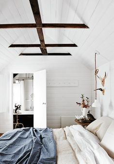 Cozy Bedrooms You'll Never Want to Leave | These bedroom ideas are full of fuzzy blankets and neutral room inspiration. Think sheepskin throws, wood accents and pillows.