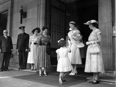Queen Elizabeth II receiving flowers after her arrival at Brisbane's City Hall on March 17, 1954. Picture by Bob Millar jnr.