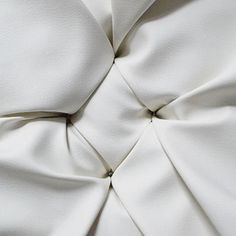 the hardest button to button a diy tufted storage ottoman, painted furniture, storage ideas, reupholster, Use screws to secure the fabric in the holes