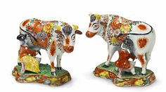 Two Delft faience figures of a lady and gentleman milking cows Figures of a Dutch couple with noir and doré decor. Unmarked. The horns and ears restored/one horn and one ear lost. H ca. 17.5 cm. 2nd half 18th C. Lempertz - JPMH
