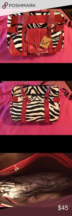 """Vegan Leather Zebra Tote Bag Brand new/never used. Vegan leather Tote. with zebra print with red vegan leather trim and silver hardware. Front zippers on front with a zipper compartment on the back. With zipper pulls. Has zipper compartment on inside. Front useable pouch on front also. 15""""w x 11""""h x 6""""d.  11"""" drop on handles. Sharp bag! Smoke and pet free home. levive Bags Totes"""