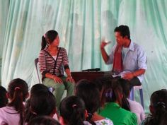 a group of Cambodian youth stage a play about the role of accompaniment in establishing children's classes.  (Childrensclasses.org)