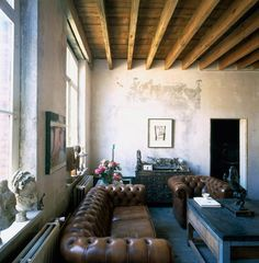 Exposed Rafters, Concrete, Chesterfield couches, Light, Textured, Rustic