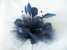 Navy Blue Ophelia Feather & Pearl Mini Fascinator Order Now from www.indigodaisyweddings.co.uk Specialising in stunning bespoke cocktail fascinators and formal hats in a wide range of colours, perfect for Royal Ascot and The Kentucky Derby. Plus all your wedding floral accessories including shoe clips, bandeau veils,vintage flapper bands, feather and flower fascinators, feather fans, fairy wands, wrist corsages, wedding bouquets & buttonholes. Worldwide Delivery. #wedding #fascinator #indigo