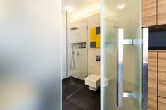 Frosted Glass Bathroom Doors Lead To Bathroom With Walk In Shower