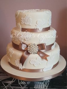 Classic ivory and lace appliqué with mink ribbon