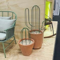 Perfect! A plant I can't kill! (Yes, I've even killed cacti 😑). Love these wire dudes at the Mexo booth at @icff_nyc.