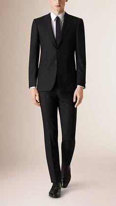 Burberry Black Modern Fit Wool Suit - A modern fit wool suit with a fitted notch lapel jacket and narrow straight leg trousers. The suit jacket is part-canvassed at the chest with a layer of natural horsehair. This moulds to the cut of the jacket, creating shape, a clean silhouette and a lightweight structure. Discover men's tailoring at Burberry.com